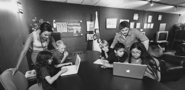 4-H kids and leaders playing games on computers